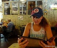 Ashton deciding what to order - a burger of course!