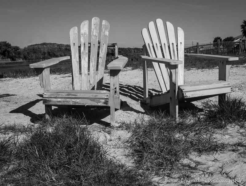 company Adirondack chairs on the beach