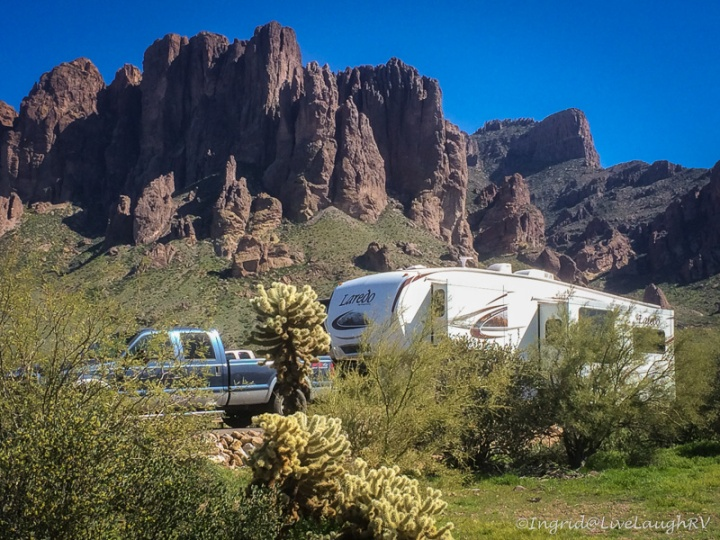 An RV camped at Lost Dutchman State Park with the Superstition mountains in the background