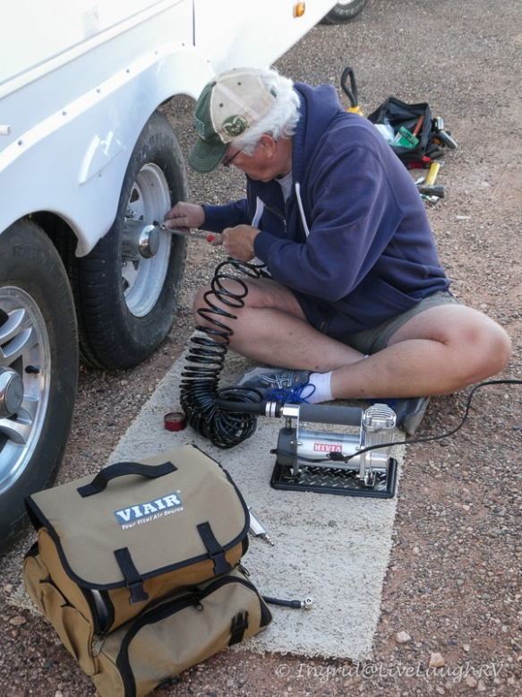 using a mobile air compressor after changing a flat tire on the RV