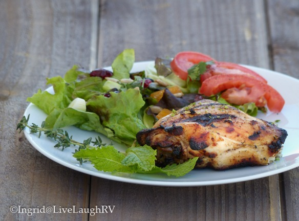 Food photograph of chicken with a side salad