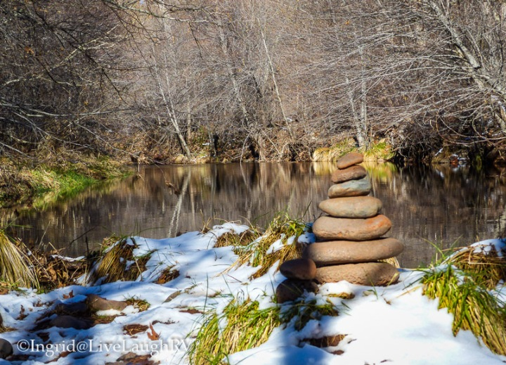 cairns surrounded by snow in Sedona, Arizona