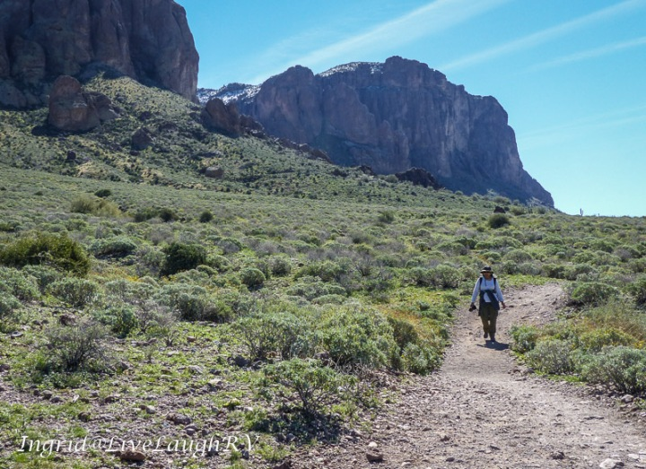 a hiker along the trail at the base of the Superstition Mountains