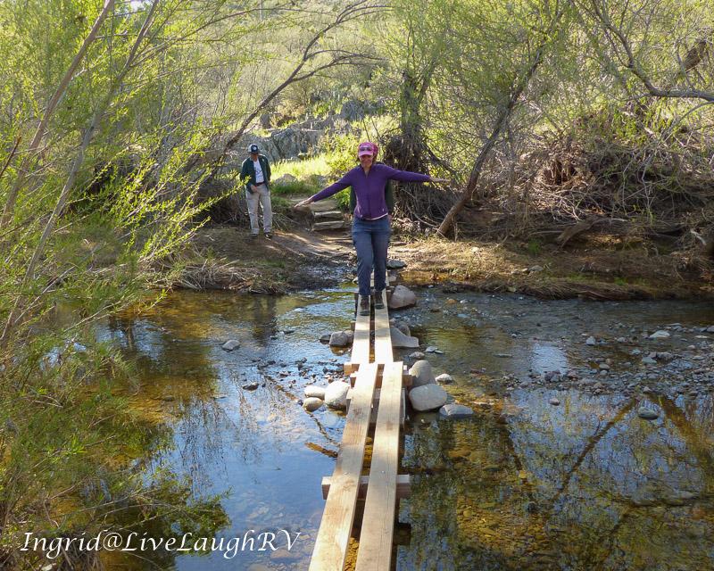 Hiking crossing a creek in Arizona