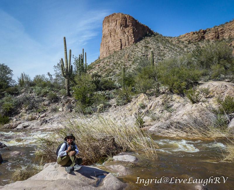 A hiker sitting on a rock along the Salt River near Tortilla Flat, AZ