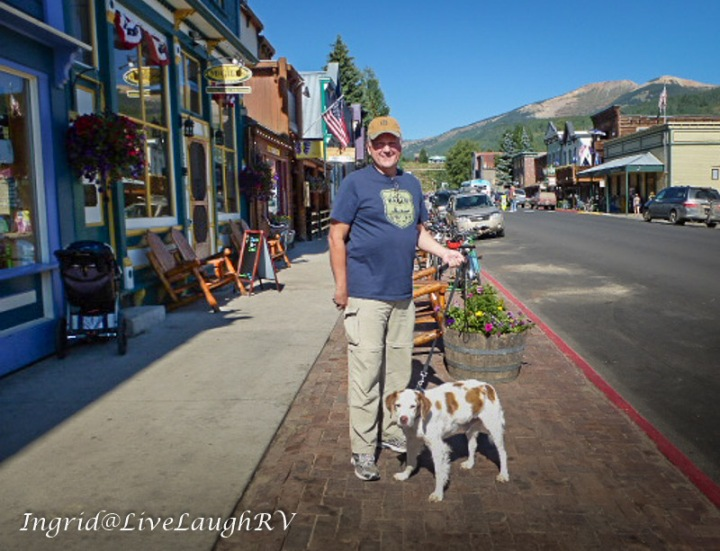 best dog friendly mountain towns, man walks do in downtown Crested Butte, #dog-friendly Colorado towns