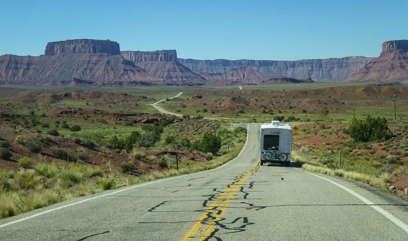 RV traveling down a deserted road in Utah