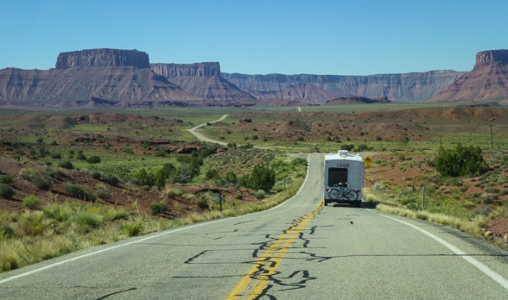 RV traveling down a deserted road in Utah