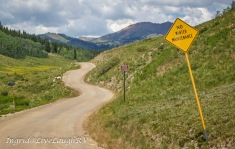exploring the backcountry near Crested Butte, Colorado, gravel road meanders in the mountains