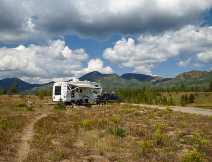 RV camped at Steamboat Springs with mountains in the background