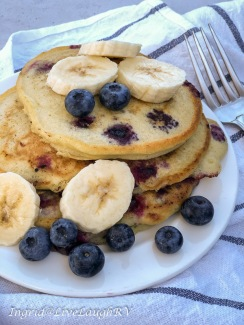 blueberry pancakes topped with banana slices