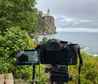 A camera shown photographing Split Rock Lighthouse