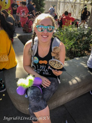 eating a large chocolate chip cookie at CA adventures