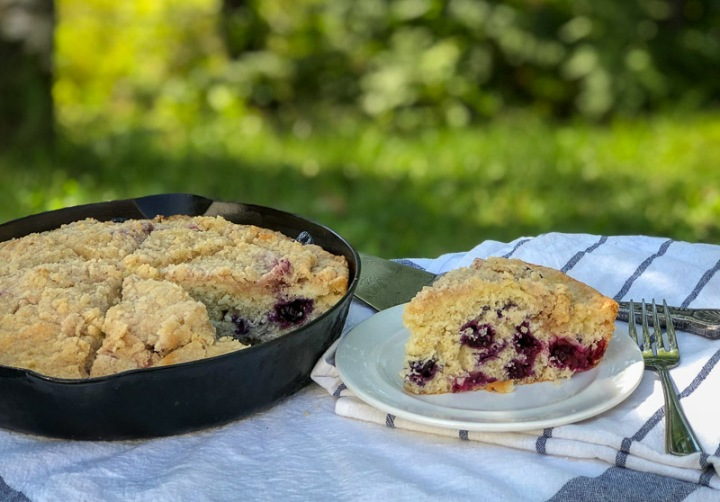 blueberry coffee cake baked in a cast iron skillet