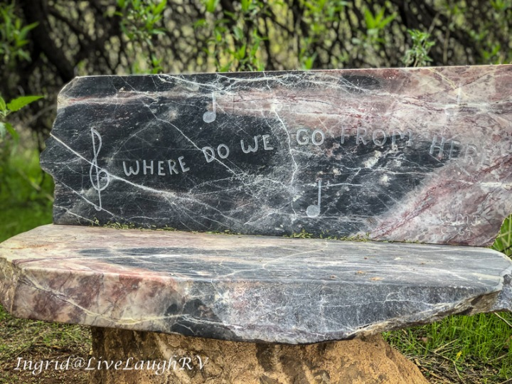 quote carved in a stone bench Where do we go from here