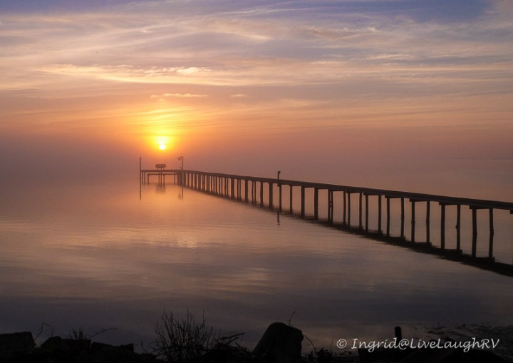 A lone dock at Sunrise across the Gulf of Mexico in Texas.