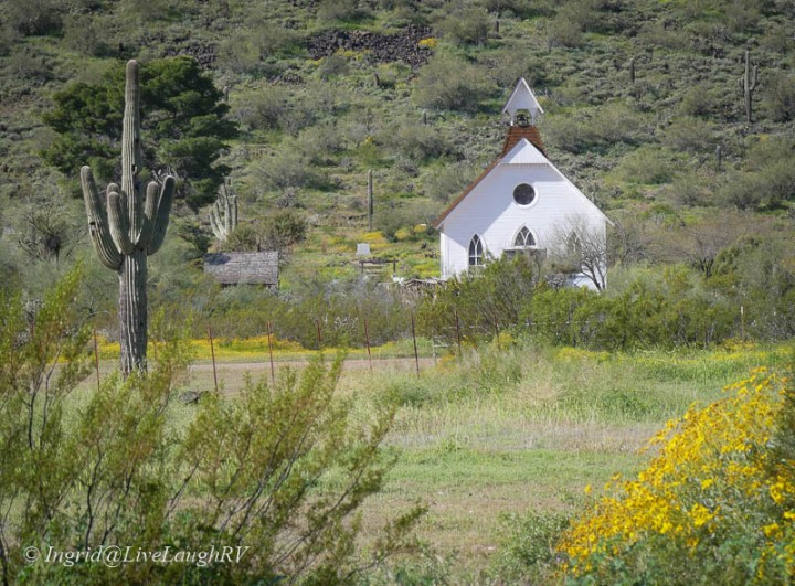 a little white church in a desert landscape