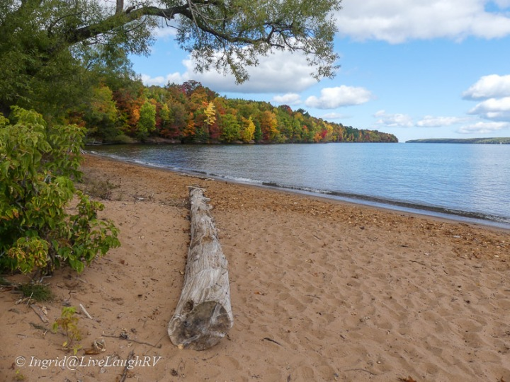 A beach along Lake Superior with fall colors
