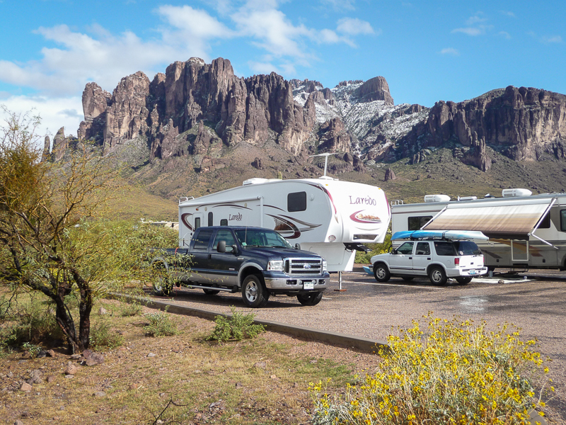 RVs camped at snow covered flatiron at the Superstition mountains